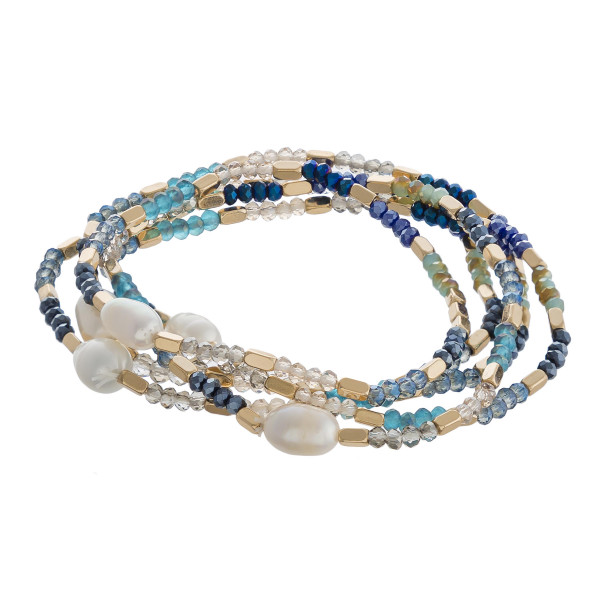 "Faceted beaded stretch bracelet set with gold and pearl bead accents. Approximately 3"" in diameter unstretched. Fits up to a 6"" wrist."