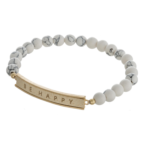 "Natural stone beaded stretch bracelet featuring a faux leather focal with ""Be Happy"" engraved details. Approximately 3"" in diameter unstretched. Fits up to a 6"" wrist."
