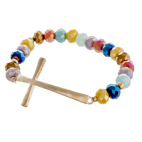 """Faceted beaded stretch bracelet featuring an east west cross focal. Approximately 3"""" in diameter unstretched. Fits up to a 6"""" wrist."""