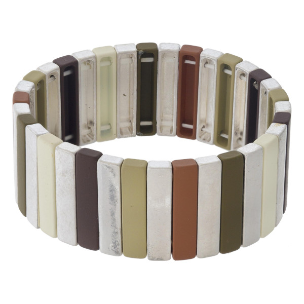 "Metal tone color block pinstripe stretch bracelet. Approximately 3"" in diameter unstretched. Fits up to a 6"" wrist."