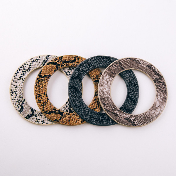 "Soft bendable faux leather snakeskin disc bracelet. Approximately 3"" in diameter. Fits up to a 6"" wrist."