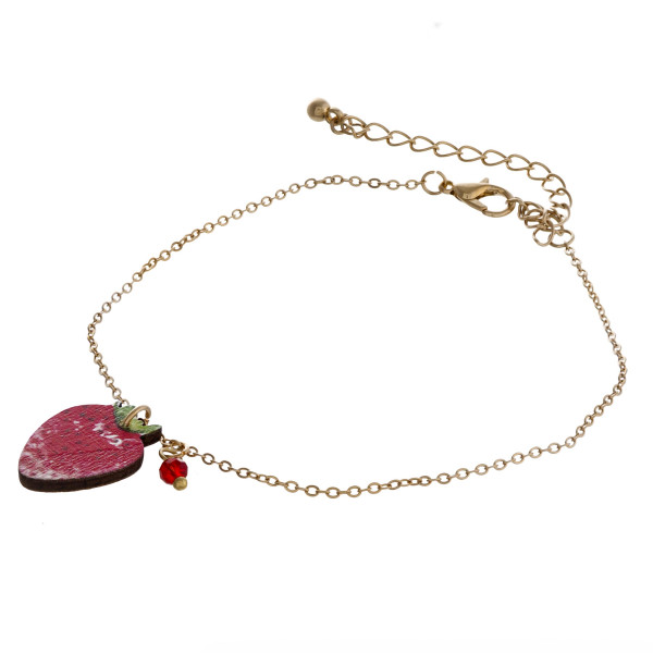 "Dainty cable chain anklet featuring a wood strawberry fruit charm. Approximately 6"" in diameter."