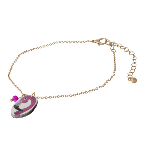 "Dainty cable chain anklet featuring a wood flamingo charm. Approximately 6"" in diameter."