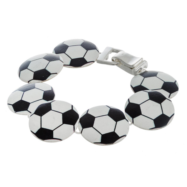 "Metal soccer print disc style bracelet with a magnetic clasp closure. Approximately 3"" in diameter. Fits up to a 6"" wrist."
