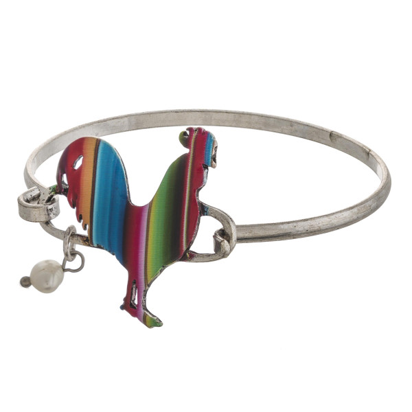 """Enamel coated serape rooster bangle bracelet with pearl accent. Approximately 3"""" in diameter. Fits up to a 6"""" wrist."""