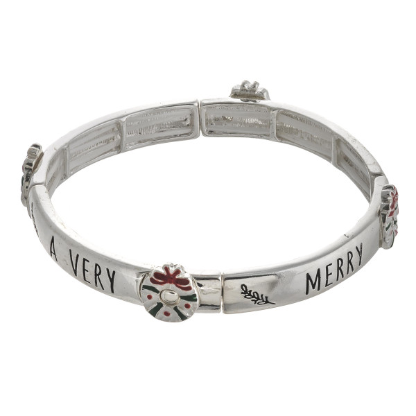 """Merry Christmas"" engraved stretch bracelet featuring an enamel coated accent. Approximately 2.5"" in diameter unstretched. Fits up to a 5"" wrist."