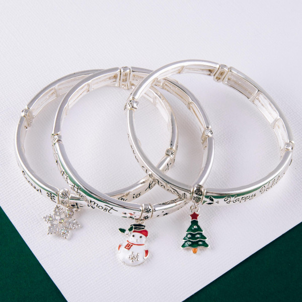 """Let it Snow"" engraved stretch bracelet with enamel coated charm. Approximately 2.5"" in diameter unstretched. Fits up to a 5"" wrist."