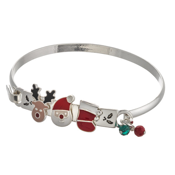 "Enamel coated Christmas character bangle bracelet. Approximately 2.5"" in diameter. Fits up to a 5"" wrist."