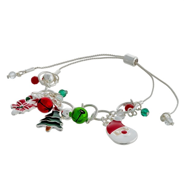 """Assorted enamel coated Christmas jingle bell charm bracelet with adjustable bolo closure. Approximately 3"""" in diameter. Fits up to a 10"""" wrist."""
