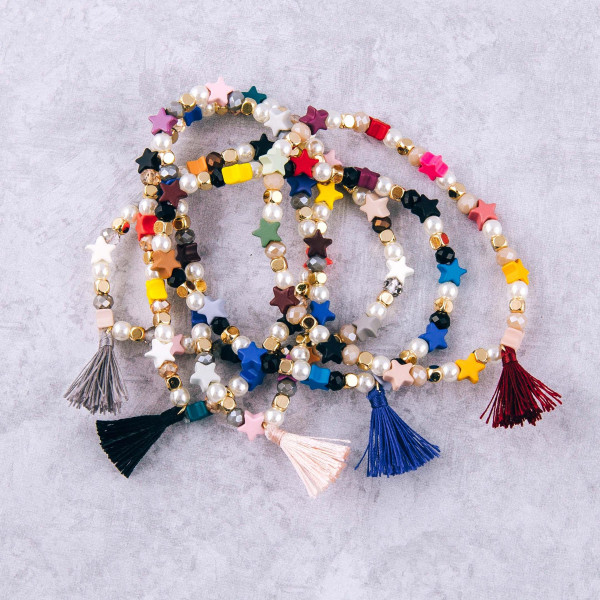 "Color block star and pearl beaded stretch bracelet with tassel accent. Approximately 3"" in diameter unstretched. Fits up to a 6"" wrist."