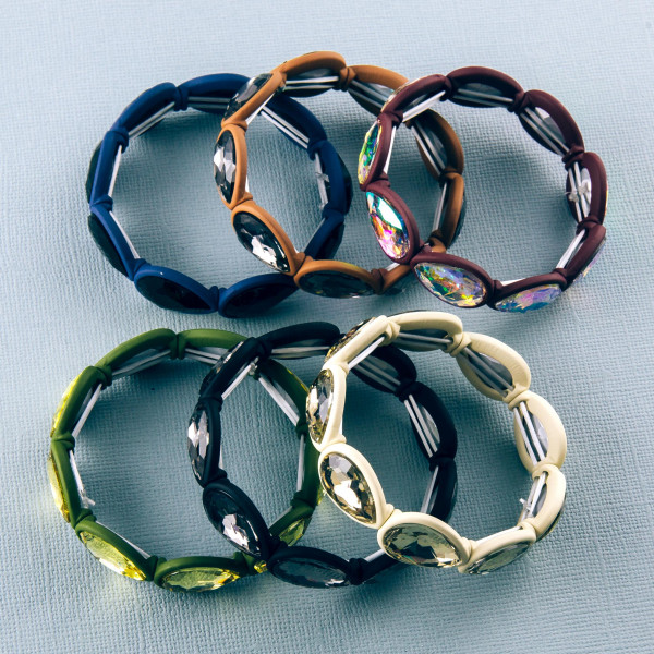 """Two tone rhinestone teardrop stretch bracelet. Approximately 3"""" in diameter unstretched. Fits up to a 6"""" wrist."""