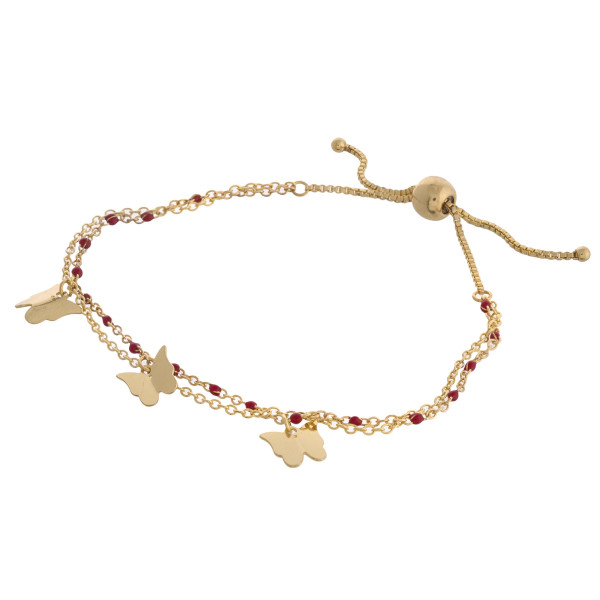 "Dainty layered butterfly bolo bracelet. Approximately 3"" in diameter. Fits up to a 6"" wrist with adjustable bolo closure."