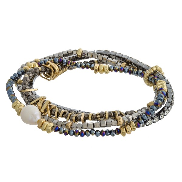 """Seed beaded bracelet set of four with gold and pearl accents.   - Approximately 3"""" in diameter unstretched - Fits up to a 6"""" wrist"""