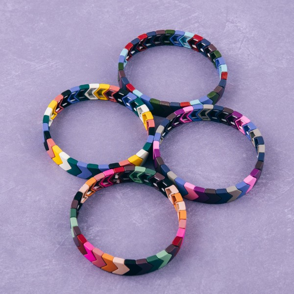 "Chevron color block stretch bracelet. Approximately 3"" in diameter unstretched. Fits up to a 6"" wrist."