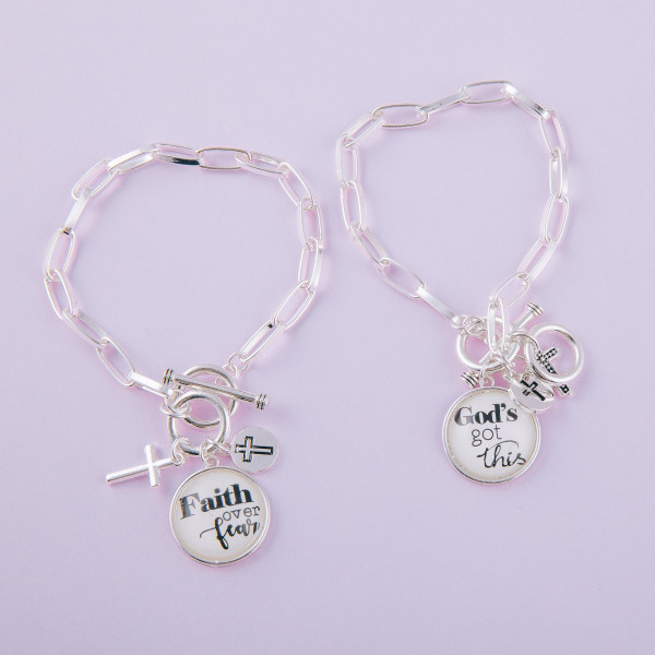 "Chain linked toggle clasp charm bracelet featuring round dome ""God's Got This"" illustration details. Approximately 3"" in diameter. Fits up to a 6"" wrist."