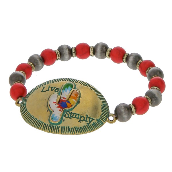 """Semi precious beaded stretch bracelet featuring a patina tone focal with """"Live Simply"""" engraved details.  - Approximately 3"""" in diameter unstretched - Fits up to a 6"""" wrist"""