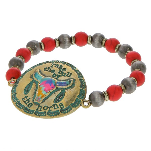 "Semi precious beaded stretch bracelet featuring patina tone focal with ""Take the bull by the horns"" engraved details.  - Approximately 3"" in diameter unstretched - Fits up to a 6"" wrist"