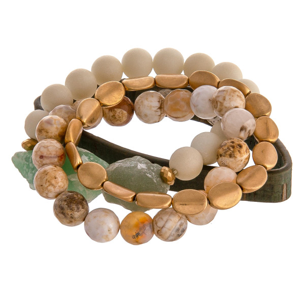 """Semi precious beaded stretch bracelet set featuring a faux cork strand with snap closure. Approximately 3"""" in diameter unstretched. Fits up to a 6"""" wrist."""