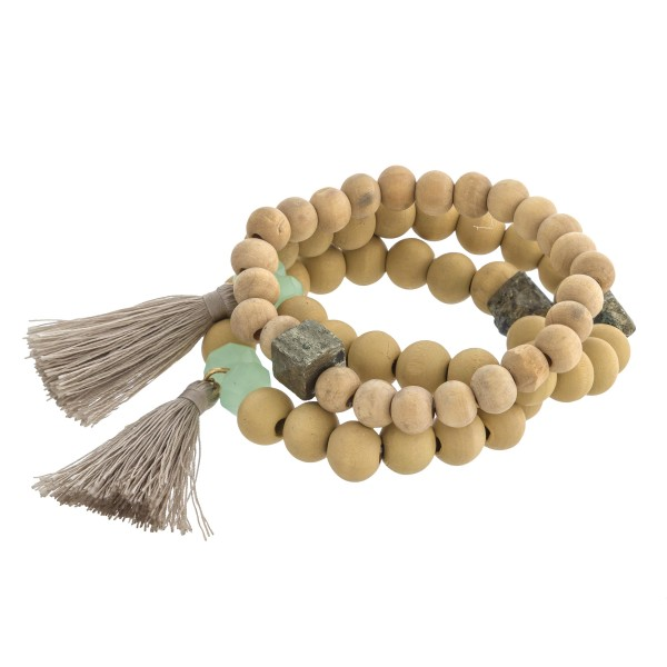 "Wood beaded stretch bracelet set of three with tassel and natural stone details. Approximately 3"" in diameter unstretched. Fits up to a 6"" wrist."