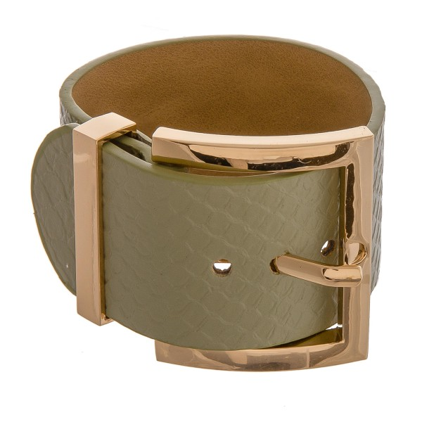 """Faux leather snakeskin adjustable buckle bracelet. Approximately 3"""" in diameter and 1.5"""" in width."""