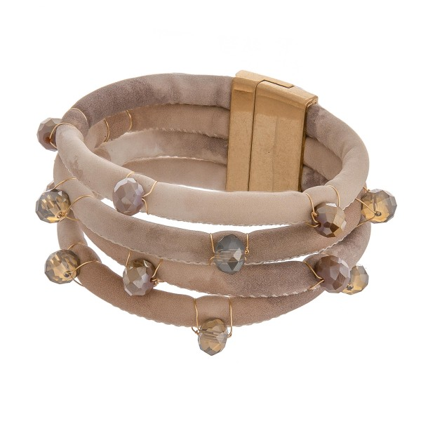 "Bead accented faux suede multi strand magnetic bracelet.   - Approximately 3"" in diameter - Approximately 1.5"" in width - Fits up to a 6"" wrist"