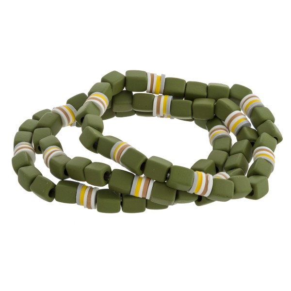 """Coated beaded stretch bracelet set of three featuring multicolor spacer bead details. Approximately 3"""" in diameter unstretched. Fits up to a 6"""" wrist."""