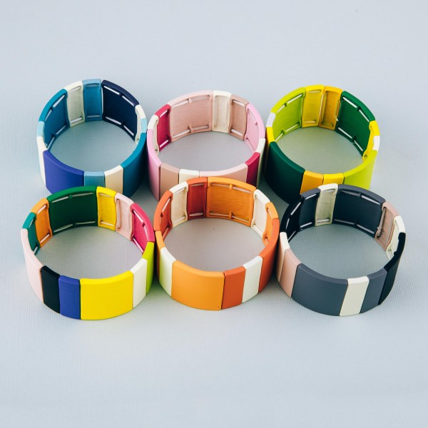 """Coated color block stretch bracelet. Approximately 3"""" in diameter unstretched and 1"""" in width. Fits up to a 6"""" wrist."""