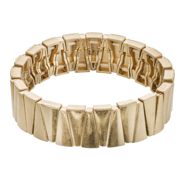 """Metal triangular beaded stretch bracelet. Approximately 3"""" in diameter unstretched. Fits up to a 6"""" wrist."""