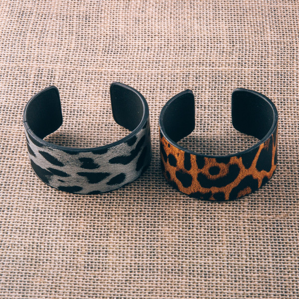 "Faux leather leopard print cuff bracelet. Approximately 2.75"" in diameter. Fits up to a 5.5"" wrist."