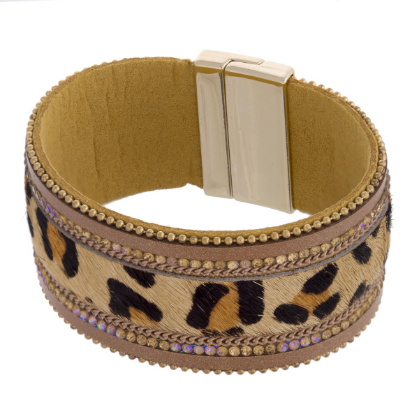 "Faux fur leopard print magnetic bracelet featuring rhinestone and bead accents. Approximately 3"" in diameter and 1.25"" in width."