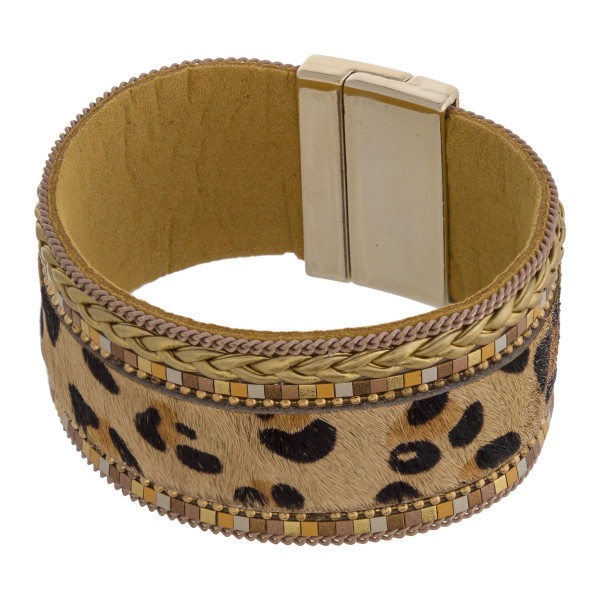 "Faux fur leopard print magnetic bracelet featuring braided details. Approximately 3"" in diameter and 1"" in width. Fits up to a 6"" wrist."