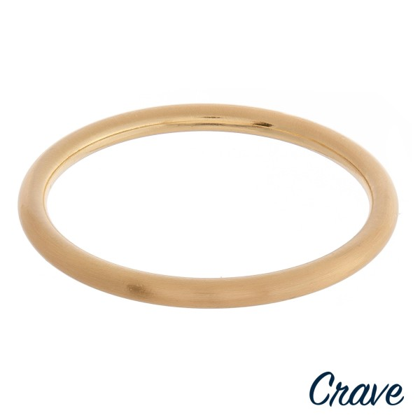 "Matte metal bangle bracelet.  - Approximately 3"" in diameter - Fits up to a 6"" wrist"