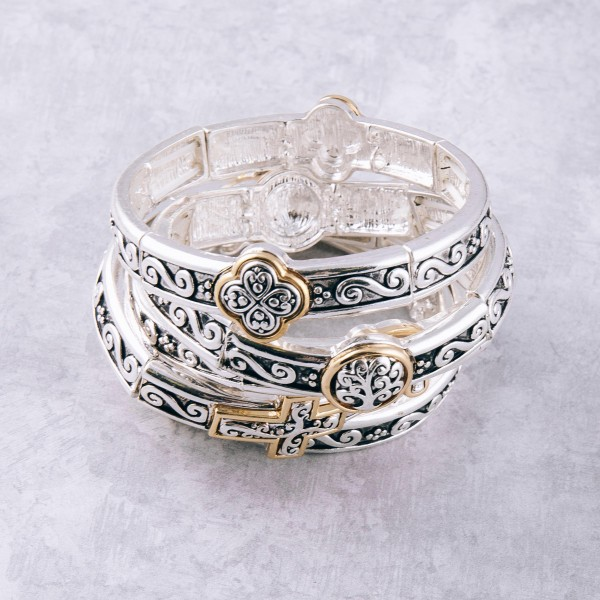 """Two tone antique silver metal clover filigree stretch bracelet. Approximately 3"""" in diameter unstretched. Fits up to a 6"""" wrist."""