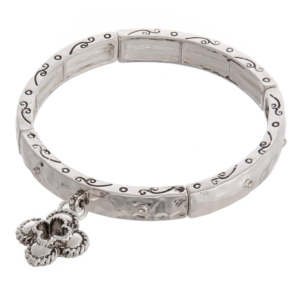 """Silver hammered metal flower charm stretch bracelet.  - Approximately 3"""" in diameter unstretched - Fits up to a 6"""" wrist"""