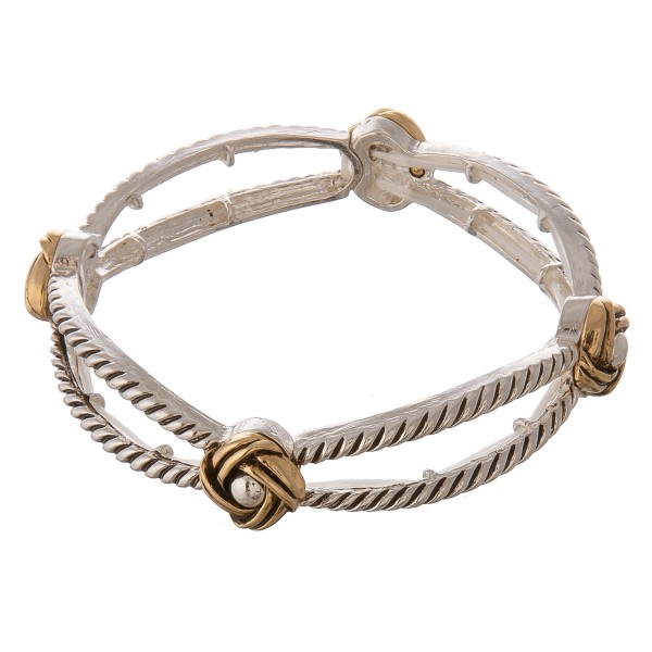 "Two tone twisted cut out stretch bangle bracelet.  - Approximately 3"" in diameter unstretched - Fits up to a 7"" wrist"