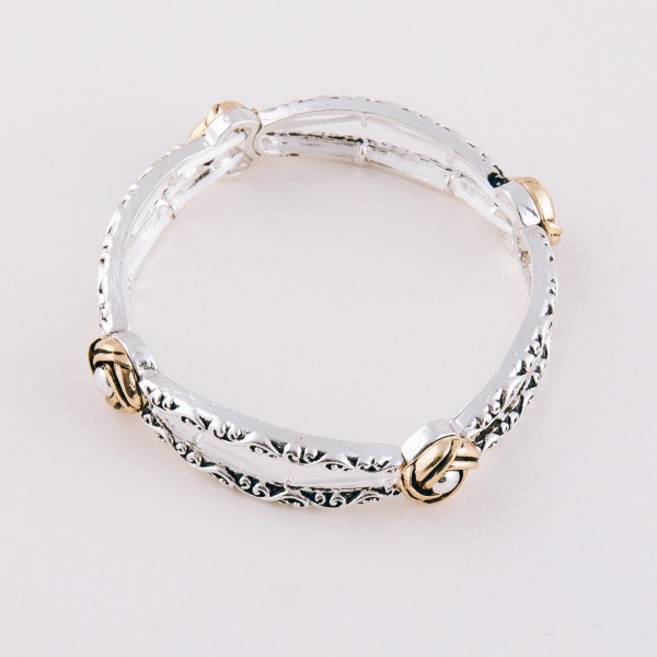 "Two tone open cut filigree stretch bracelet.  - Approximately 3"" in diameter unstretched - Fits up to a 7"" wrist"