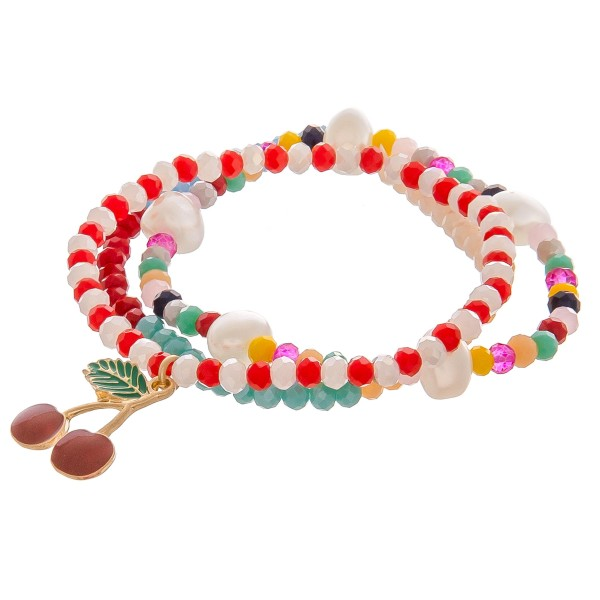 "Enamel coated cherry charm multicolor beaded stretch bracelet set of three with pearl details.  - Approximately 3"" in diameter unstretched  - Fits up to a 6"" wrist"