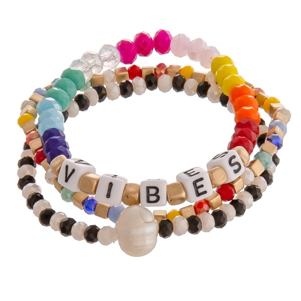 "Multicolor beaded ""Vibes"" letter block pearl stretch bracelet set.  - 3pcs/set - Approximately 3"" in diameter unstretched - Fits up to a 7"" wrist"