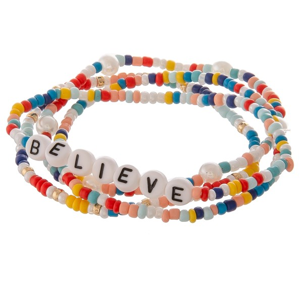 "Multicolor seed beaded ""Believe"" letter stretch bracelet set with pearl details.  - 4pcs/pack - Approximately 3"" in diameter unstretched - Fits up to a 7"" wrist"