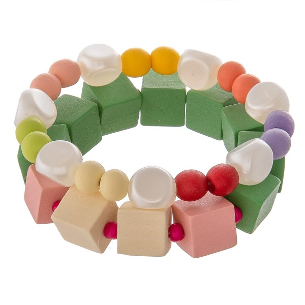 "Chunky wood color block beaded stretch bracelet set with faux pearl accents.  - 2pcs/pack - Approximately 3"" in diameter unstretched - Fits up to a 7"" wrist"