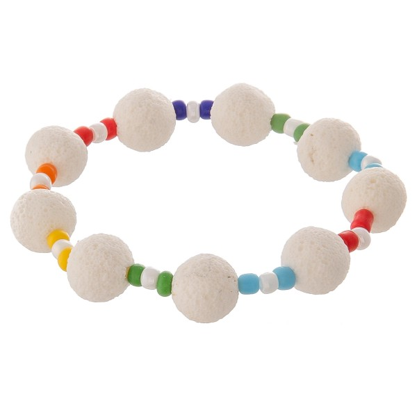 "Lava rock beaded stretch bracelet with multicolor seed beads.  - Approximately 3"" in diameter unstretched - Fits up to a 7"" wrist"