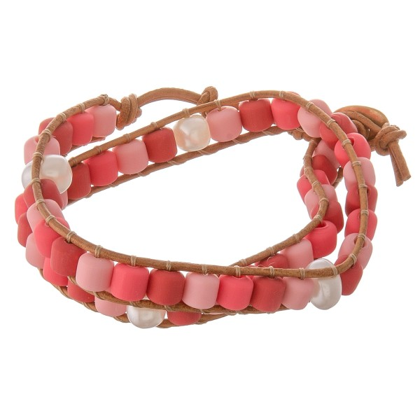 "Rubber beaded color block cord wrap bracelet with pearl accents.  - Pull through button clasp - Adjustable 2"" extender - Approximately 3"" in diameter - Fits up to an 7"" wrist"