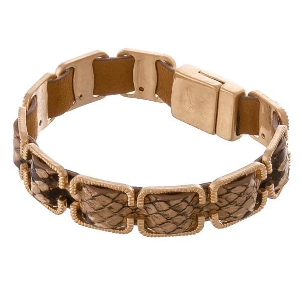 "Faux leather snakeskin woven buckle bracelet with magnetic closure.  - Approximately 3"" in diameter - Fits up to a 6"" wrist"