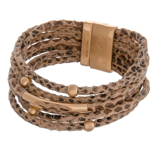 "Multi strand faux leather snakeskin magnetic bracelet.  - Magnetic closure - Approximately 3"" in diameter - Fits up to a 6"" wrist"