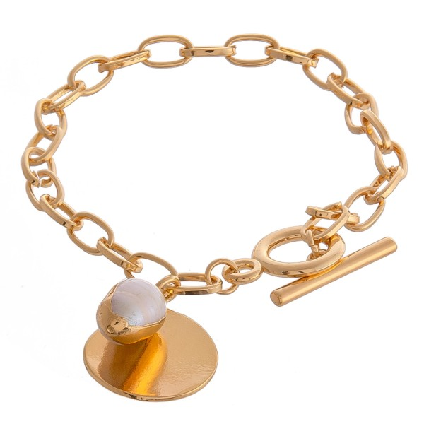 "Metal chain linked faux pearl charm toggle bracelet.  - Approximately 3.5"" in diameter - Fits up to a 7"" wrist"