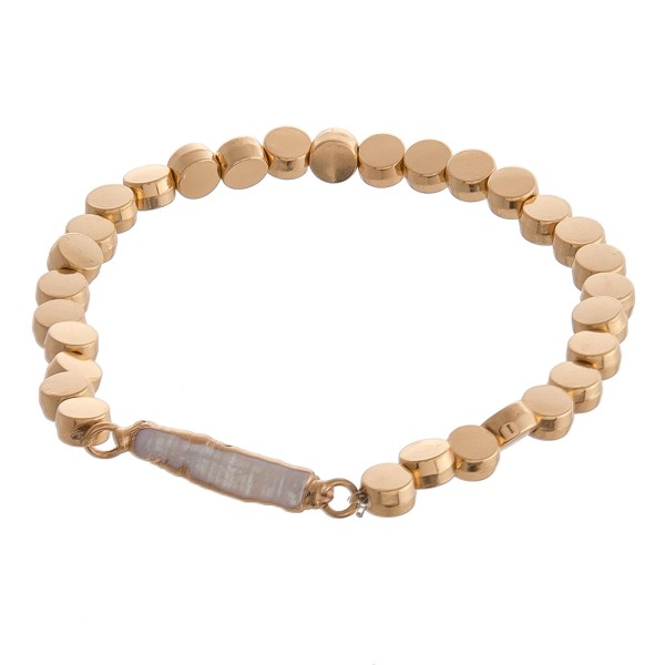 """Metal disc beaded faux pearl stretch bracelet.  - Approximately 3"""" in diameter unstretched - Fits up to a 6"""" wrist"""