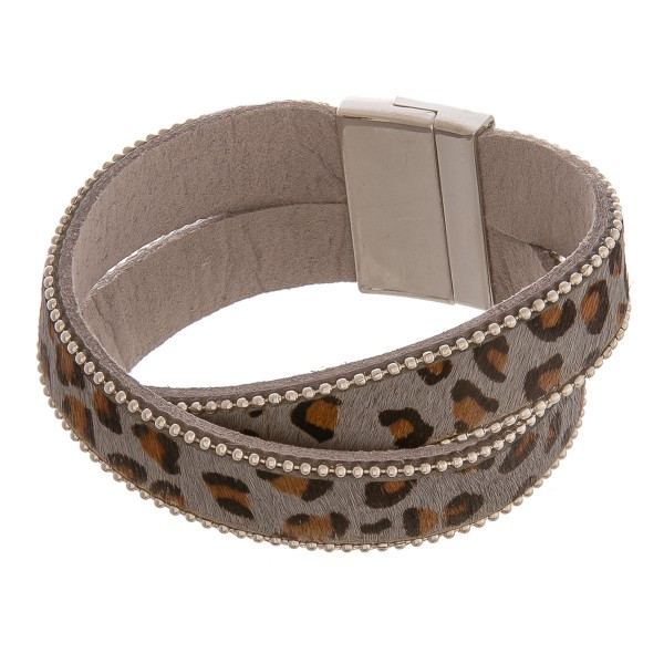 "Faux leather criss-cross leopard print magnetic bracelet.  - Magnetic closure - Approximately 3"" in diameter - Fits up to a 6"" wrist"