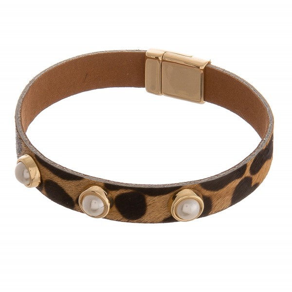 "Cowhide leopard print pearl stud magnetic bracelet.  - Magnetic closure - Approximately 3"" in diameter  - Fits up to a 6"" wrist"
