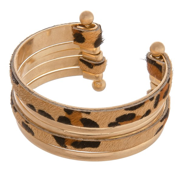 """Cowhide leopard print metal bangle cuff bracelet.  - Approximately 2.5"""" in diameter - Fits up to a 5"""" wrist"""