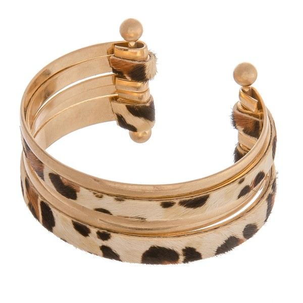 "Cowhide leopard print metal bangle cuff bracelet.  - Approximately 2.5"" in diameter - Fits up to a 5"" wrist"